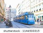 blue tram on shopping street in ... | Shutterstock . vector #1146503315