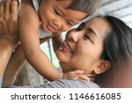 the warmth between mother and... | Shutterstock . vector #1146616085