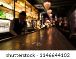 a glass of white wine on the... | Shutterstock . vector #1146644102