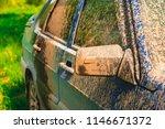 fragment of dirty car in rural... | Shutterstock . vector #1146671372