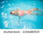 little kid swimming in pool. | Shutterstock . vector #1146680525
