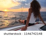 Attractive Woman Enjoys Sailin...