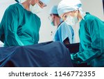 doctors and surgeons operating... | Shutterstock . vector #1146772355