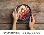 woman holding bowl of tasty... | Shutterstock . vector #1146773738