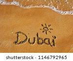 dubai word on sand beach ... | Shutterstock . vector #1146792965