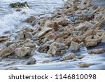 wet rock and sand on the beach. ... | Shutterstock . vector #1146810098