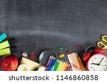 School supplies on black board...