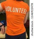 a girl in an orange t shirt...   Shutterstock . vector #1146922478