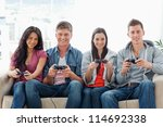 a smiling group of friends sit... | Shutterstock . vector #114692338