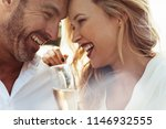 close up of smiling couple with ... | Shutterstock . vector #1146932555