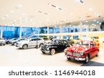 blurred dealership store  with... | Shutterstock . vector #1146944018