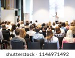 speaker giving a talk in... | Shutterstock . vector #1146971492