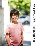 confident kid in pink t shirt ... | Shutterstock . vector #1147015502