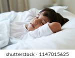 fast asleep kid in bed  close up | Shutterstock . vector #1147015625