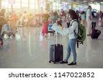 young girl traveler reading... | Shutterstock . vector #1147022852