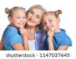 grandmother with two adorable... | Shutterstock . vector #1147037645