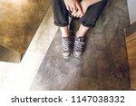 feet of a girl in modern... | Shutterstock . vector #1147038332