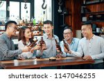 cheerful group of asian men and ... | Shutterstock . vector #1147046255