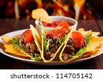 plate with taco  nachos chips... | Shutterstock . vector #114705142