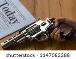 gun in hand with blur soft... | Shutterstock . vector #1147082288