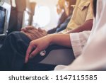 passenger sitting on a seat row ... | Shutterstock . vector #1147115585