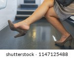 high heel shoes dangling | Shutterstock . vector #1147125488