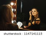 attractive young woman with...   Shutterstock . vector #1147141115