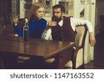 man and girl sharing bottle of... | Shutterstock . vector #1147163552