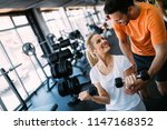 working out in fitness center | Shutterstock . vector #1147168352