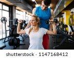 beautiful woman helped by... | Shutterstock . vector #1147168412