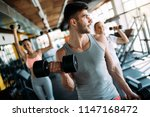 determined male working out in... | Shutterstock . vector #1147168472