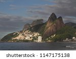favela at the foot of the...   Shutterstock . vector #1147175138
