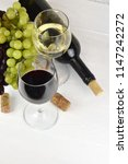 glass of white and red wine on... | Shutterstock . vector #1147242272