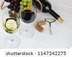 glass of white and red wine on... | Shutterstock . vector #1147242275