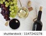 glass of white and red wine on... | Shutterstock . vector #1147242278