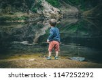 little boy by the forest lake ... | Shutterstock . vector #1147252292