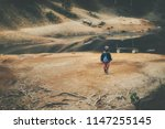 little boy walking away from... | Shutterstock . vector #1147255145