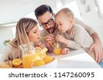 cheerful young family making... | Shutterstock . vector #1147260095