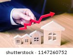 the hand holds a red arrow...   Shutterstock . vector #1147260752