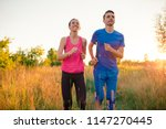 active sportive couple running... | Shutterstock . vector #1147270445