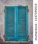 wooden grunge shutters window.... | Shutterstock . vector #1147290515