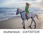 beautiful young woman walking... | Shutterstock . vector #1147337135