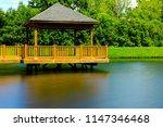 Wooden Gazebo On Lake