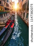 canal with gondolas in venice ... | Shutterstock . vector #1147382075