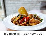 spaghetti with spicy mixed... | Shutterstock . vector #1147394708