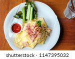 top view of creamy omelet with... | Shutterstock . vector #1147395032