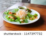 salmon wasabi spicy salad. it... | Shutterstock . vector #1147397732