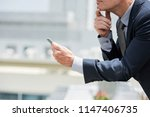 cropped image of business... | Shutterstock . vector #1147406735