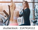two beautiful girls engaged in... | Shutterstock . vector #1147414112