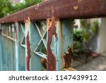 close up rusty gate outside the ... | Shutterstock . vector #1147439912